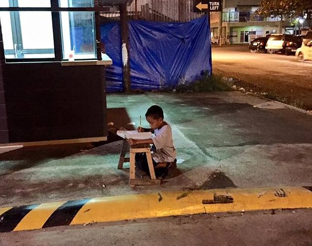 Nine-year-old Filipino pictured studying in the light of a McDonald's